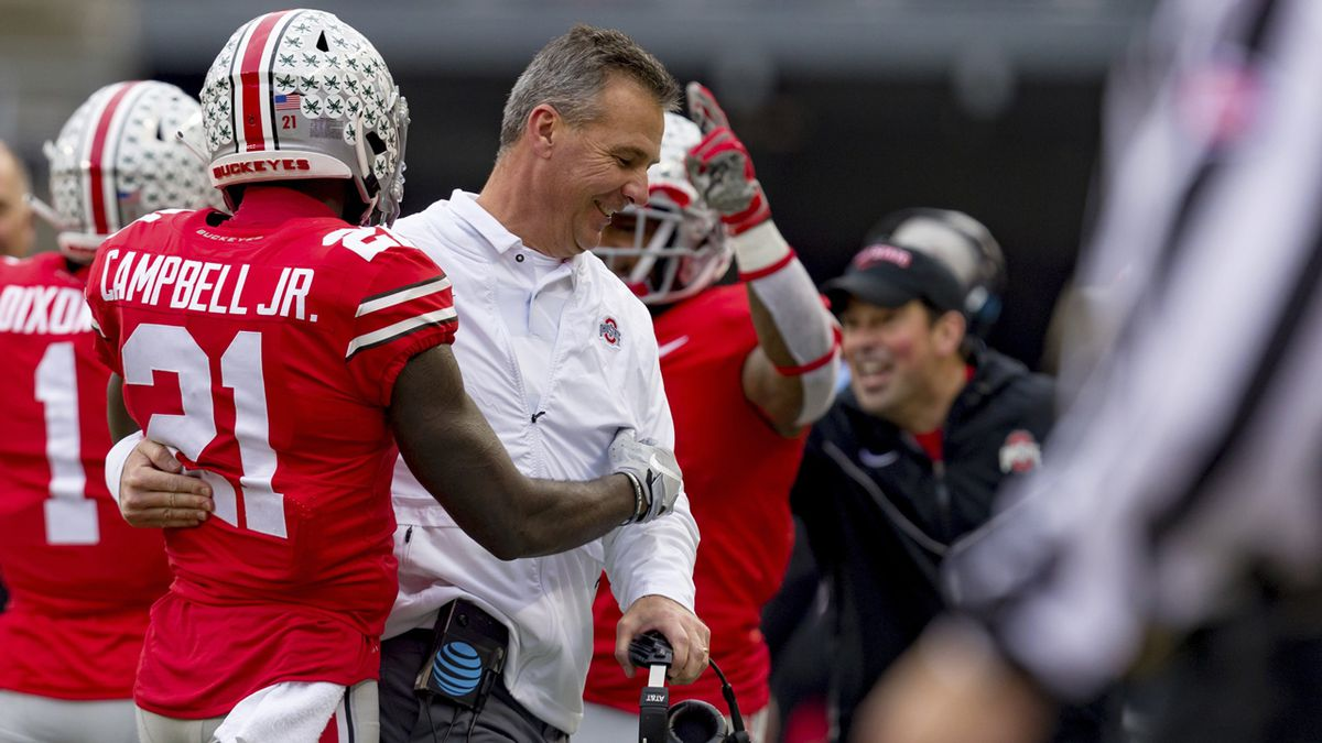 Urban Meyer smiles with wide receiver Parris Campbell during the Michigan game last month.