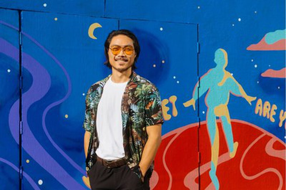 Artist Kent Yoshimura pictured in front of the mural at 6 Rose Avenue in Los Angeles' Venice...