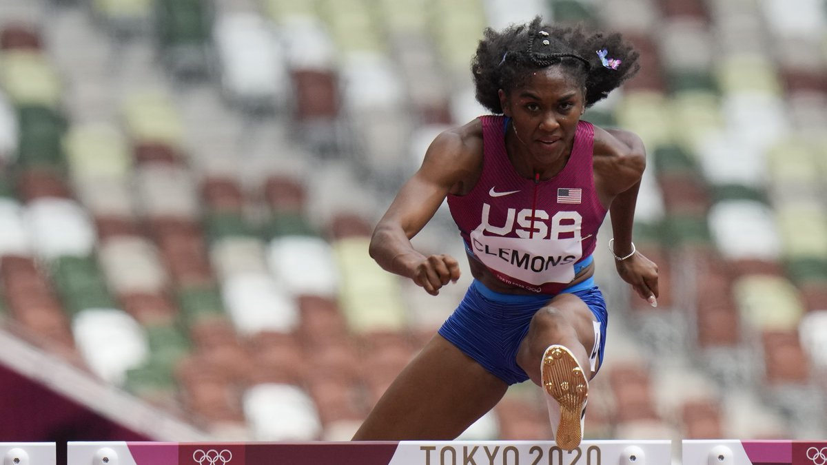 Christina Clemons, of United States, competes in a heat in the women's 100-meter hurdles at the...