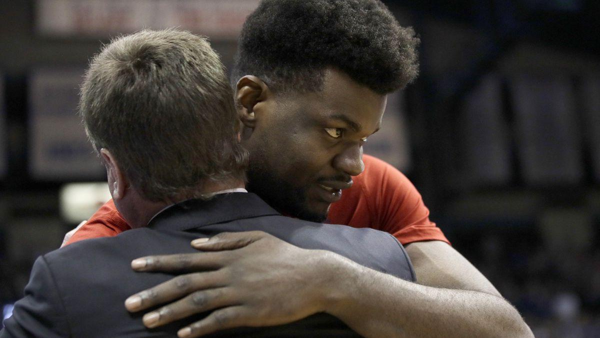 Kansas senior center Udoka Azubuike hugs coach Bill Self before the team's NCAA college...