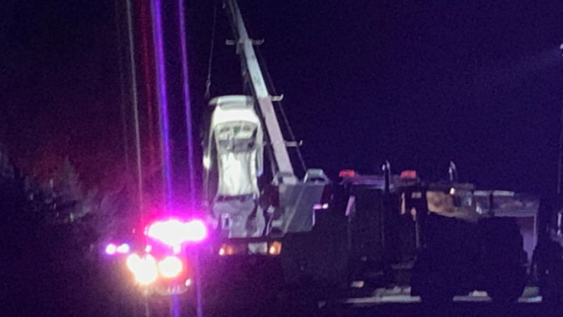 Crews pull a submerged car out of the Cottonwood River after three teens died Saturday night.