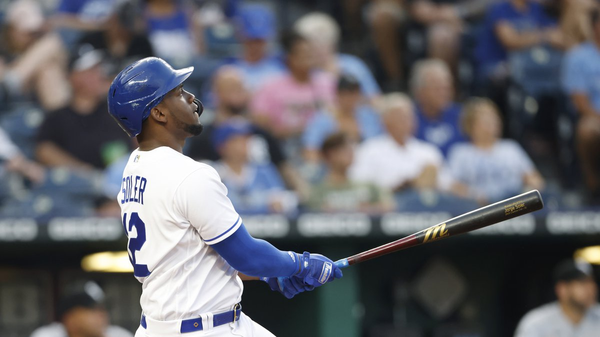 Kansas City Royals' Jorge Soler watches his second home run of the night during the fourth...