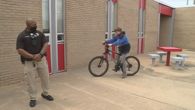 School Officer Dixon surprised 7th grader Patrick Steele with a new bike, replacing the one...