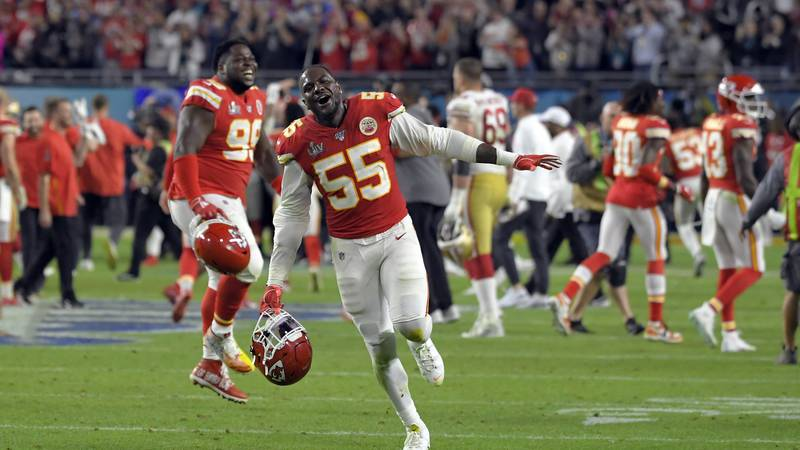 Kansas City Chiefs' Frank Clark celebrates after defeating the San Francisco 49ers in the NFL...