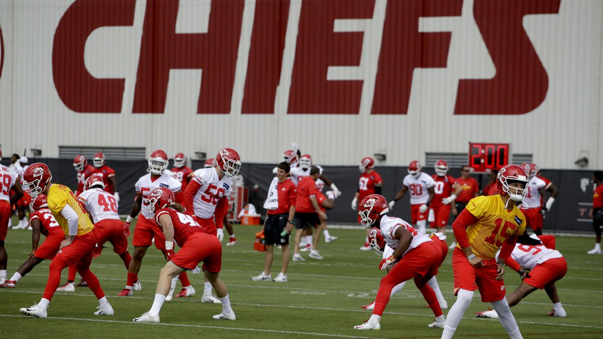 Kansas City Chiefs quarterback Patrick Mahomes (15) warms up with teammates during a workout at their NFL football training facility Wednesday, June 12, 2019, in Kansas City, Mo. (AP Photo/Charlie Riedel)