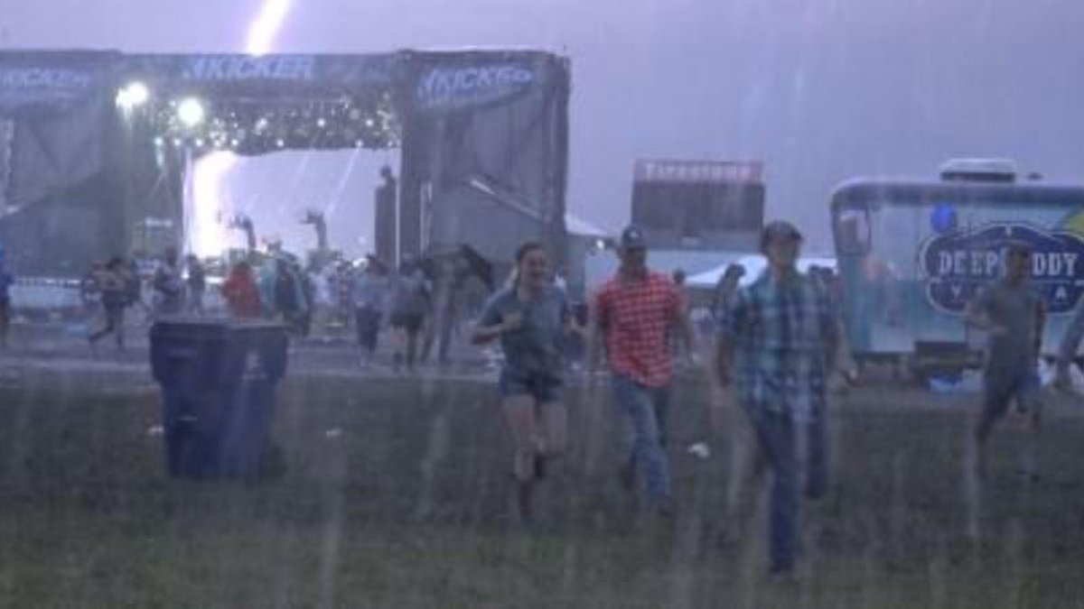 Lightning strikes near backstage at Country Stampede on the final night of the event, on June...