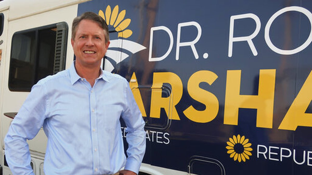 In this Thursday, Sept. 5, 2019 photo, U.S. Rep. Roger Marshall, R-Kan., stands outside an RV...