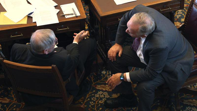 Kansas state Sens. Ron Ryckman Sr., R-Meade,, left, and John Doll, R-Garden City, confer during...