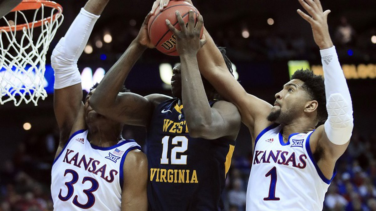 FILE - Kansas forward Dedric Lawson (1) blocks a shot by West Virginia forward Andrew Gordon...