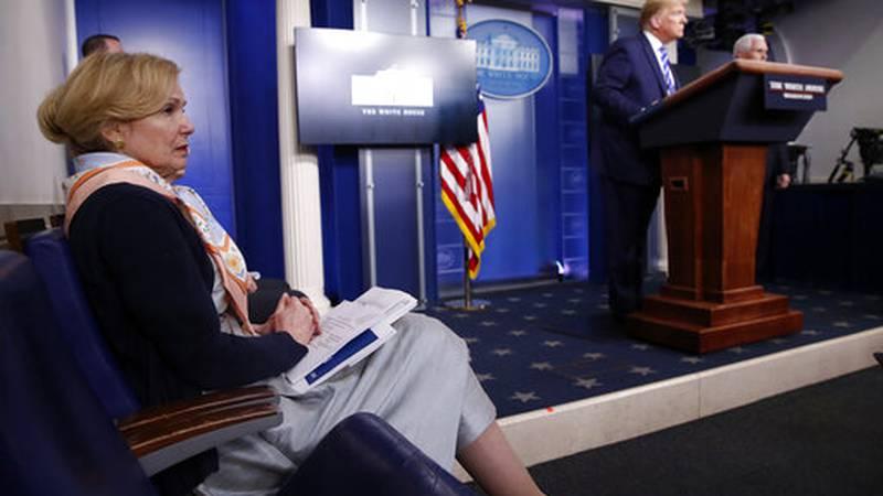 Dr. Deborah Birx, White House coronavirus response coordinator, listens as President Donald...