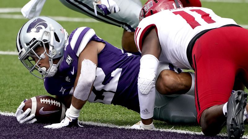 Kansas State running back Deuce Vaughn gets past Arkansas State linebacker Jaden Harris (11) to...