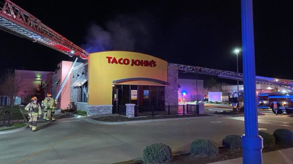 Fire crews extinguish flames at the Taco John's location on Leavenworth Street in Manhattan on...