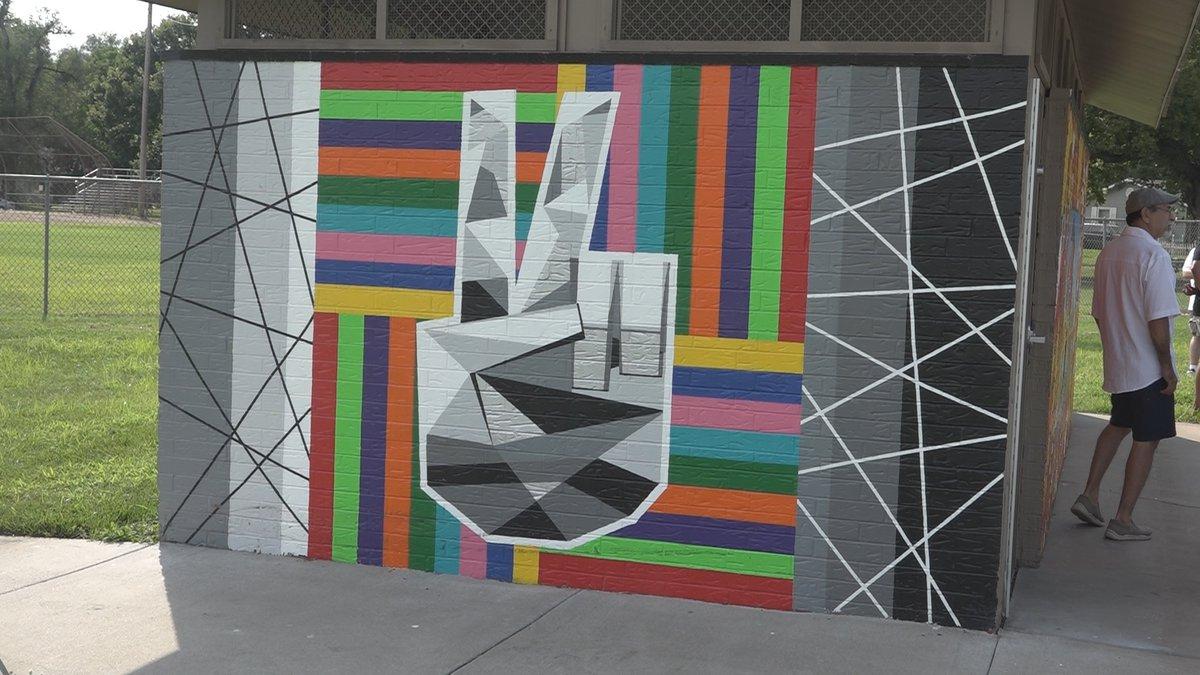 Mural complete after vandalism of Santa Fe Park building in June 2020.