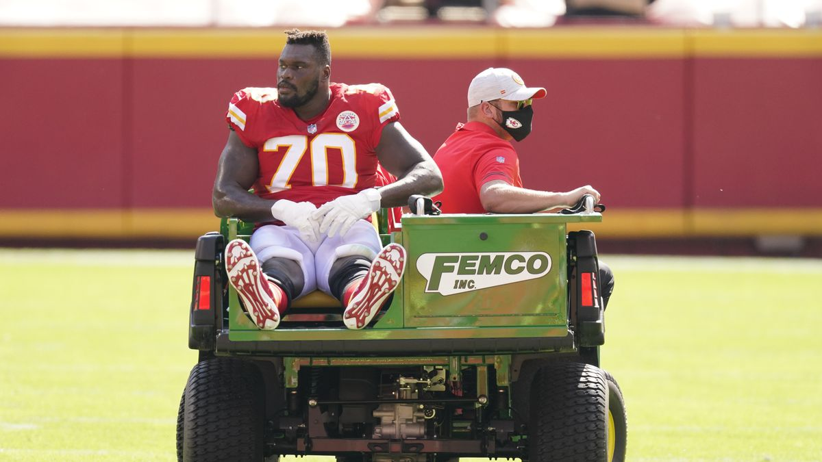 Kansas City Chiefs offensive guard Kelechi Osemele (70) is carted off the field after an injury during the first half of an NFL football game against the Las Vegas Raiders, Sunday, Oct. 11, 2020, in Kansas City. (AP Photo/Charlie Riedel)