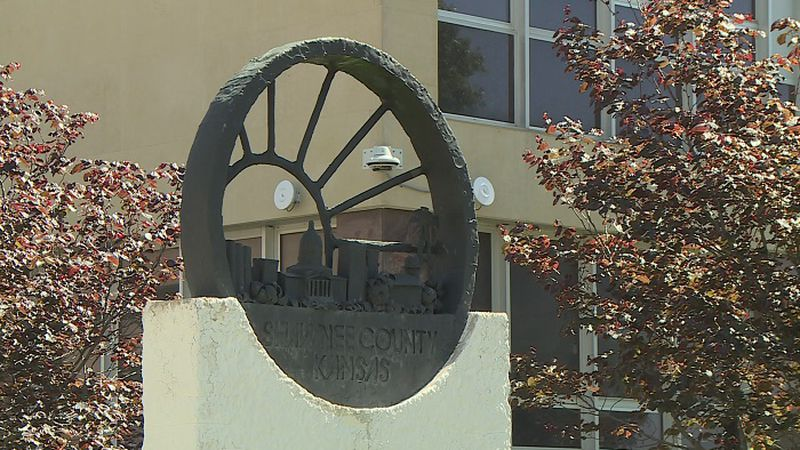 Sculpture of Shawnee Co. seal outside courthouse