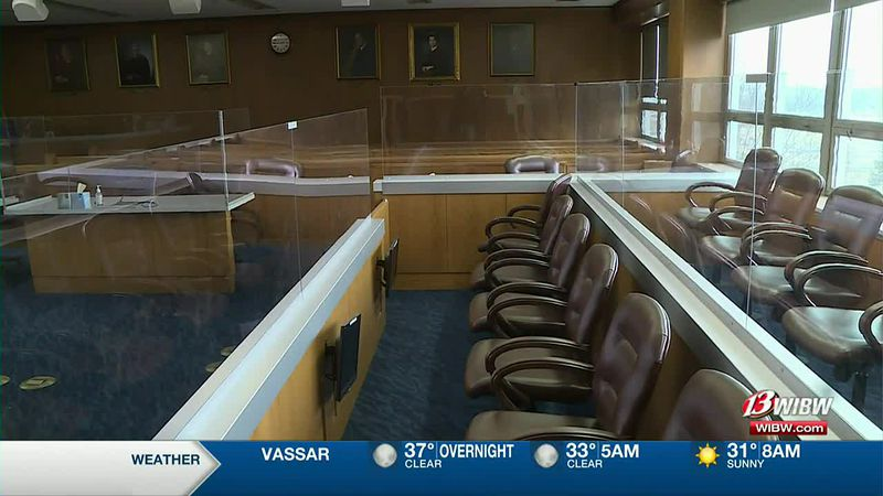 Plexiglass dividers surround the jury box in a courtroom at Shawnee Co. District Court.
