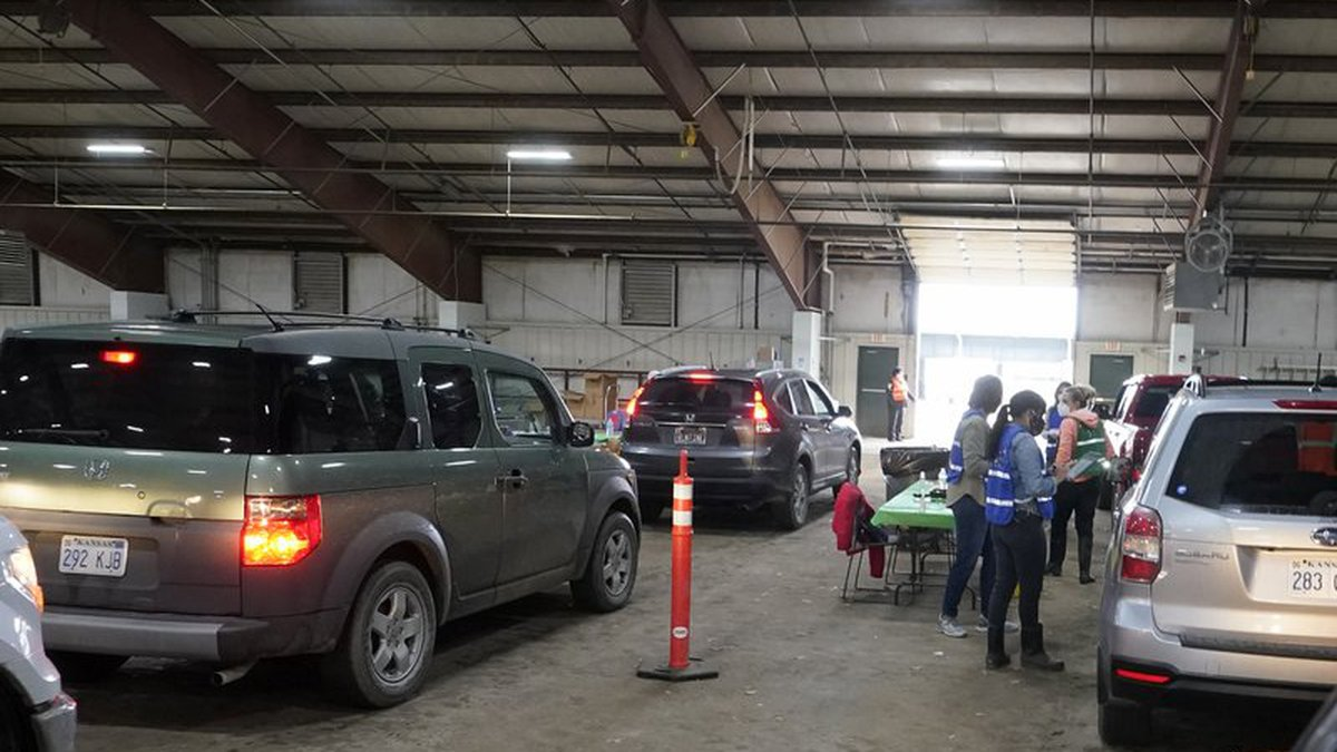 FILE - Drive-thru vaccinations are given in a building on the Douglas County Fair Grounds in...