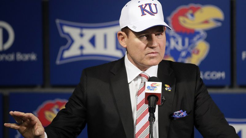 University of Kansas new football coach Les Miles makes a statement during a news conference in...