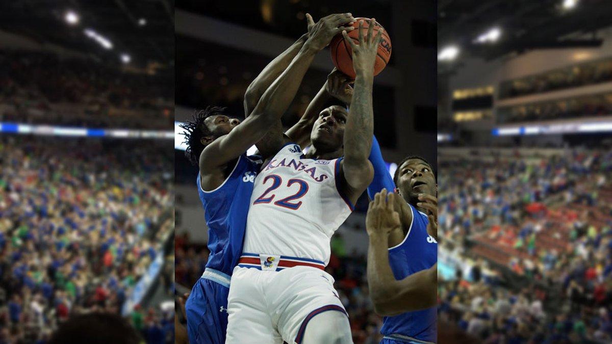 Kansas forward Silvio De Sousa (22) rebounds against Seton Hall forward Michael Nzei, left, and...