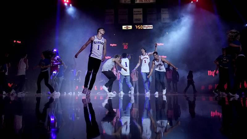 Kansas players dance during Late Night in the Phog, the school's annual NCAA college basketball...