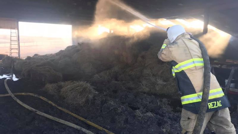 Wabaunsee fire crews battled a barn fire that had about 1,200 square bales in it on Sunday.