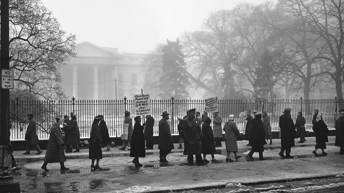 A cold, grey mist obscures the White House but pickets march through the slush in front of the...