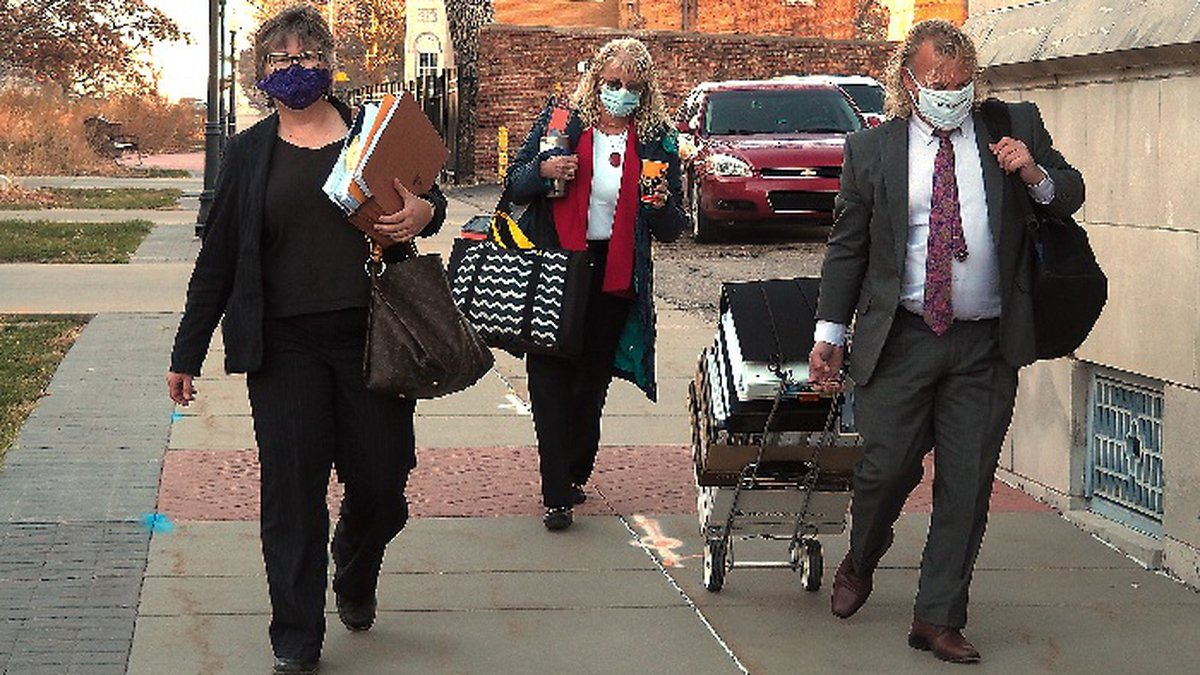 Jacqie Spradling, left, arrives with her legal team Monday, Dec. 7, 2020, for a hearing into...