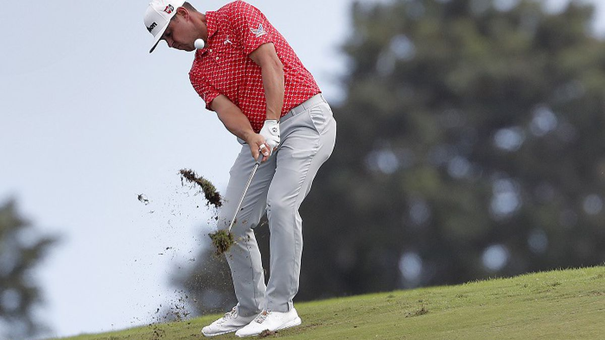 Gary Woodland hits his approach shot on the 12th fairway during the third round of the Tournament of Champions golf event, Saturday, Jan. 5, 2019, at Kapalua Plantation Course in Kapalua, Hawaii. (AP Photo/Matt York)