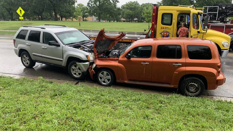 A silver Jeep Laredo and an orange Chevrolet HHR were heavily damaged in a head-on crash late...
