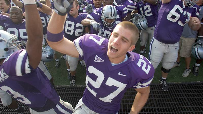 Kansas State wide receiver Jordy Nelson (27) celebrates with teammates in front of the Kansas...
