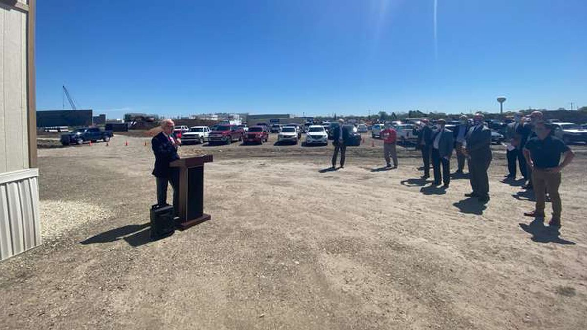 U.S. Senator Jerry Moran speaks to the group assembled at the Schwan's construction site...