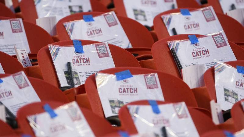 Crucial Catch pouches were taped to seats at Arrowhead Stadium before an NFL football game...