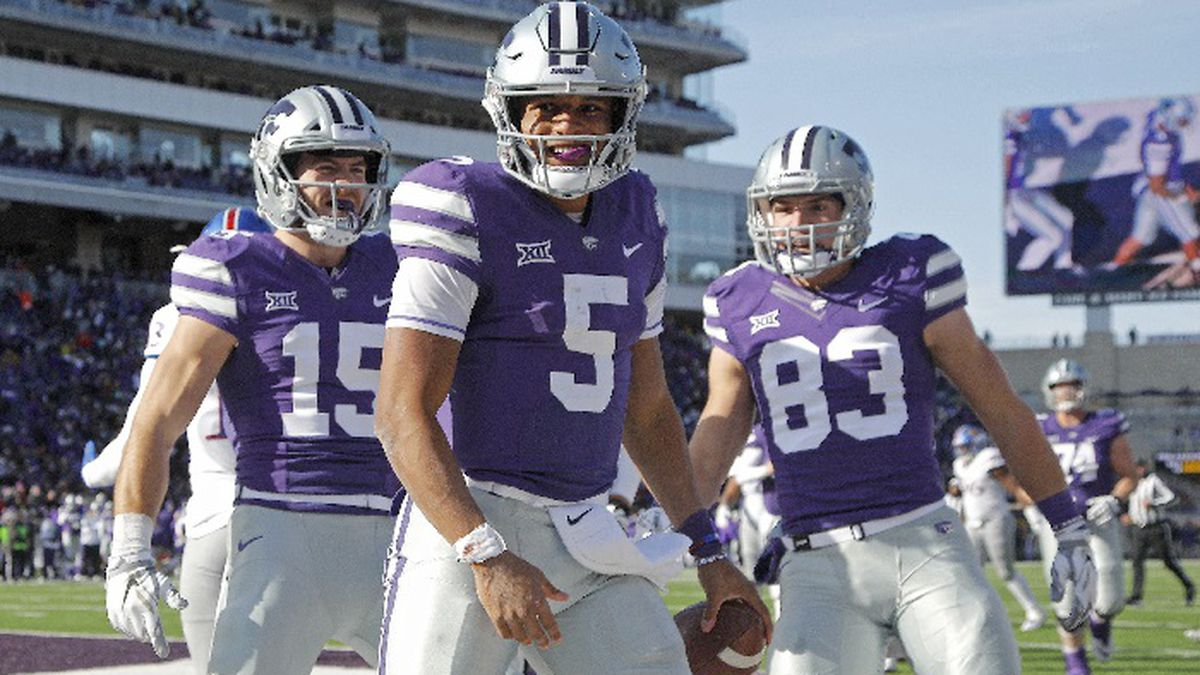 Kansas State quarterback Alex Delton (5) celebrates with wide receivers Dalton Schoen (83) and Zach Reuter (15) after Delton ran the ball for a touchdown during the second half of an NCAA college football game against Kansas Saturday, Nov. 10, 2018, in Manhattan, Kan. Kansas State won 21-17. (AP Photo/Charlie Riedel)