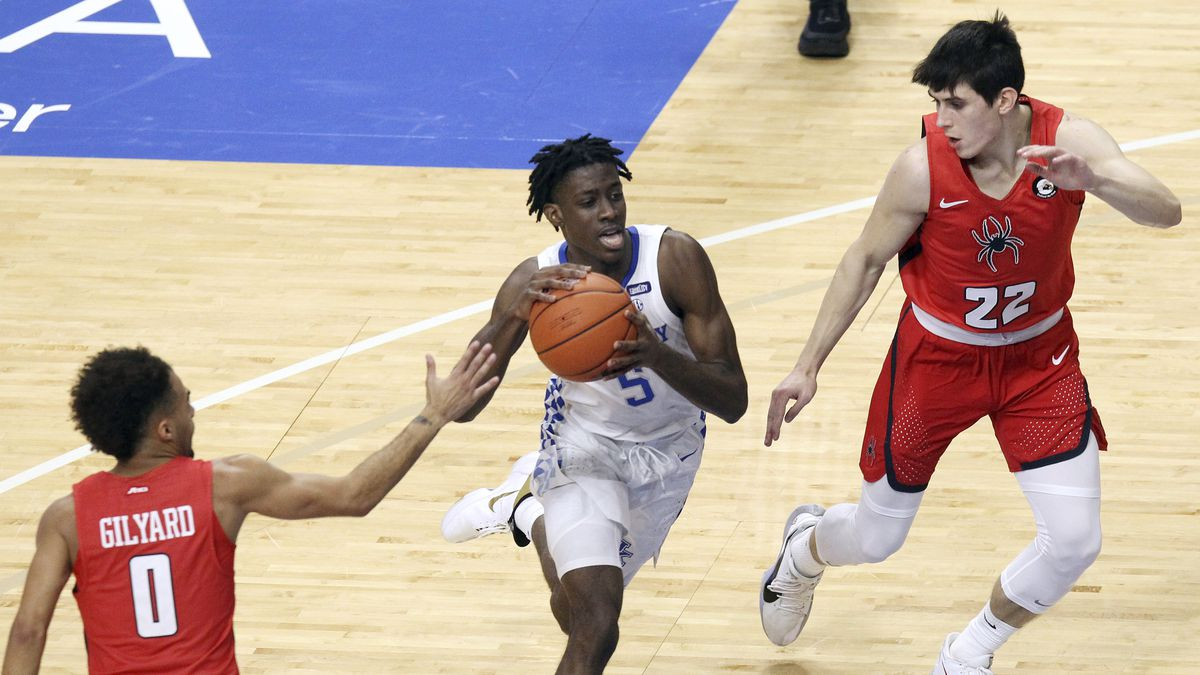 In this Nov. 29, 2020, file photo, Kentucky's Terrence Clarke, center, drives between...
