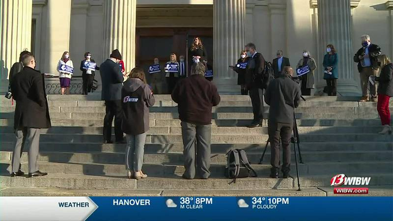FILE - Lawmakers and lobbyists gather on the steps of the Kansas Statehouse in support of the...