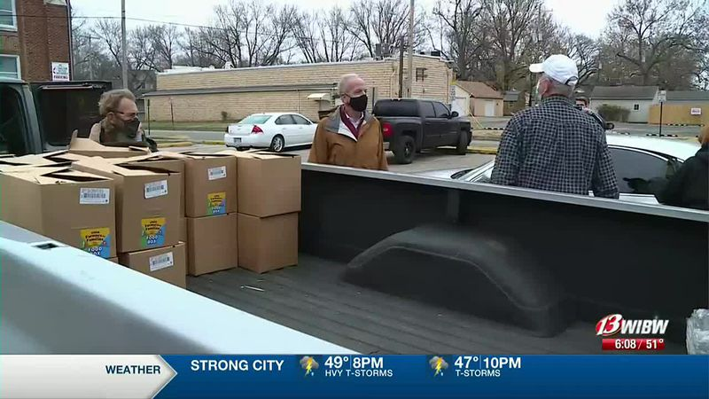 Sen. Jerry Moran (center) joins members of Operation Food Secure for a food distribution at...