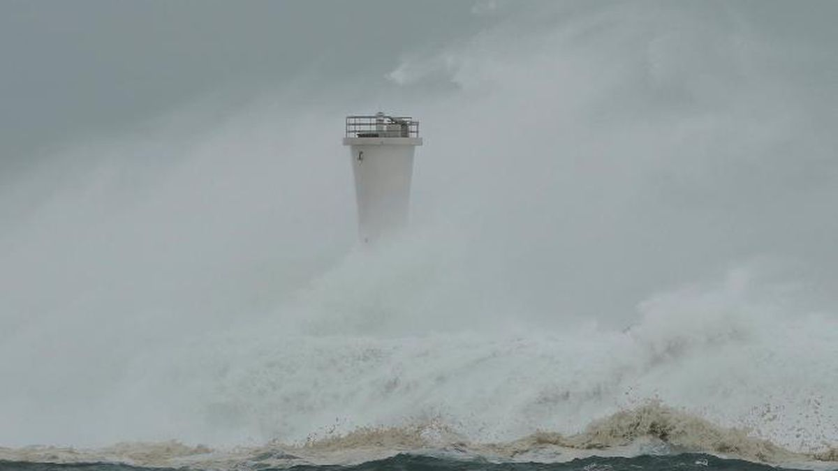 Surging waves hit against the breakwater and a lighthouse as Typhoon Hagibis approaches at a port in town of Kiho, Mie prefecture, central Japan Saturday, Oct. 12, 2019. Tokyo and surrounding areas braced for a powerful typhoon forecast as the worst in six decades, with streets and trains stations unusually quiet Saturday as rain poured over the city. (AP Photo/Toru Hanai)