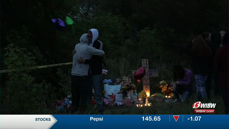 People gathered Tuesday night to remember three teens killed in a car wreck near Emporia.