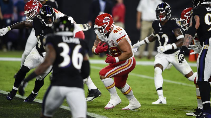 Kansas City Chiefs running back Anthony Sherman (42) runs for a touchdown after his pass...