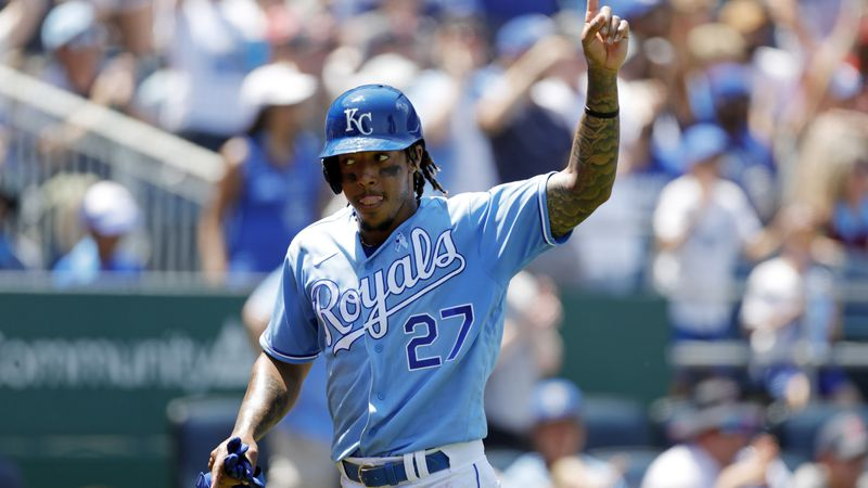 Kansas City Royals' Adalberto Mondesi reacts after scoring off a Jarrod Dyson double in the...
