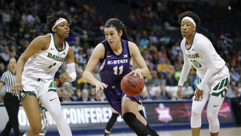 Kansas State forward Peyton Williams (11) drives to the basket between Baylor forward NaLyssa...