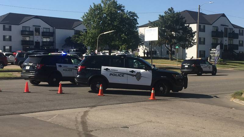 Topeka Police investigate an accident involving a motorcycle just north of 21st and Fairlawn