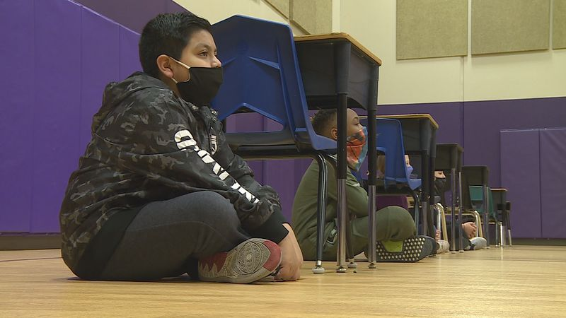 Students at Topeka's McCarter Elementary School joined in the statewide tornado drill to...