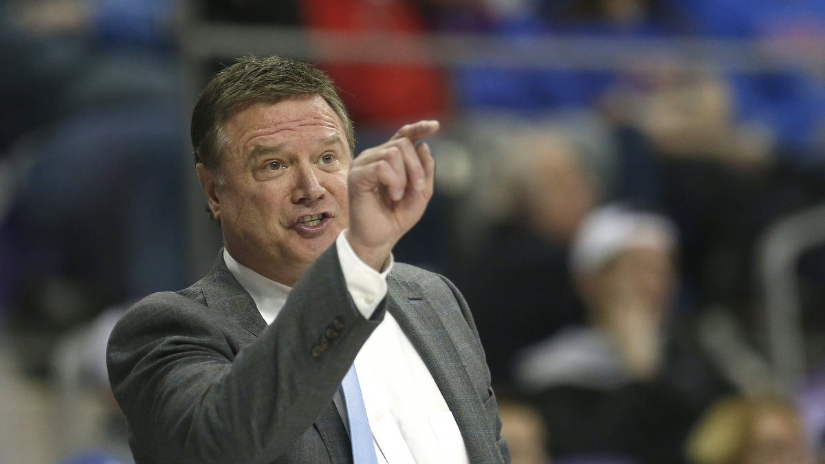 Kansas head coach Bill Self talks with one of his players during the second half of an NCAA...