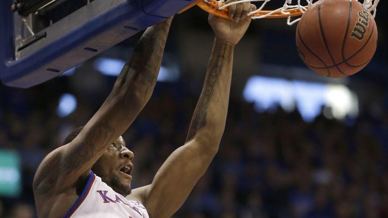 Kansas forward Cliff Alexander (2) dunks during the first half of an NCAA college basketball...