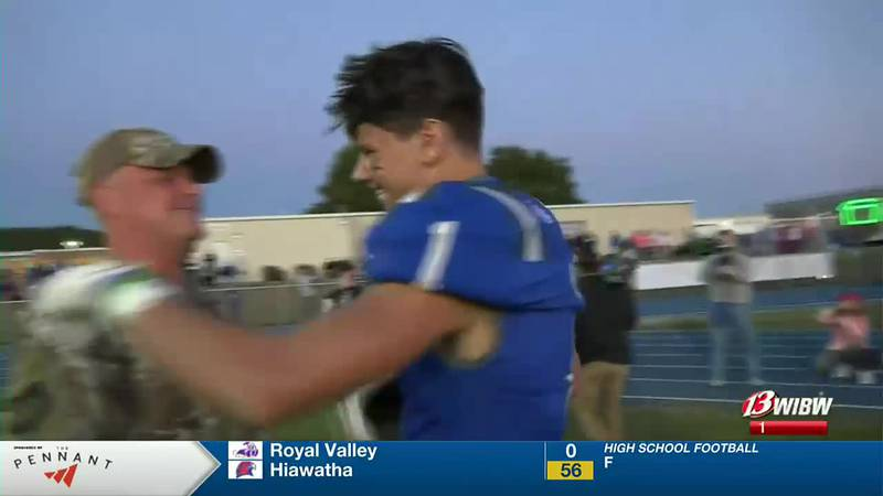 Military dad surprises son with return at Perry-Lecompton game
