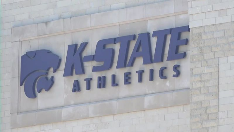 Christianna Carr and her fellow K-State athletes are united. All Wildcat athletes are standing...