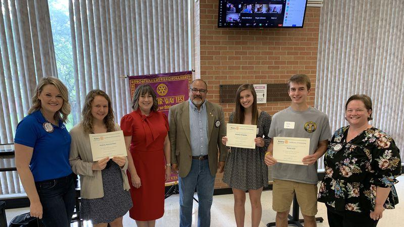 The Topeka South Rotary Club on Friday awarded $500 scholarships to three seniors at Shawnee...
