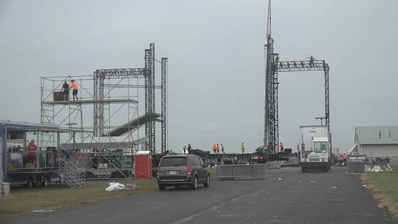 Crews disassemble the Country Stampede stage on Sunday, June 27, 2021.
