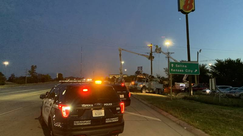 Topeka police and Evergy crews were on the scene of a power outage that resulted from a vehicle...